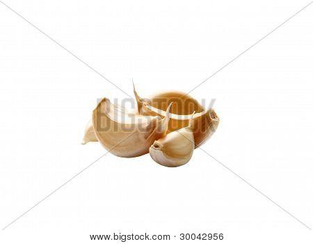 Garlic cloves isolated on white
