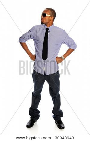 Portrait of African American man standing with hands akimbo isolated over white background
