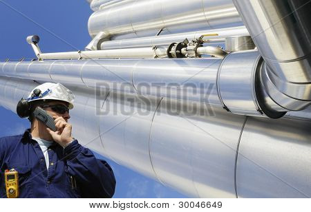 oil and gas worker with giant pipes and pipelines