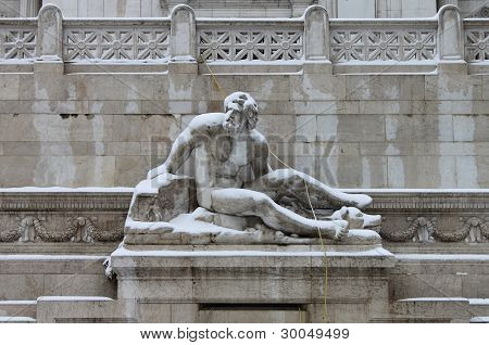 Statues in Venice square of Rome under snow