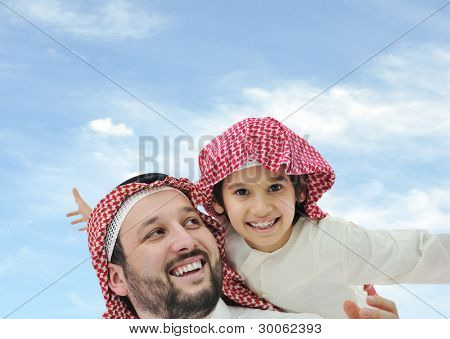 Saudi father and his little boy on shoulders