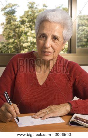 Portrait Of A Senior Lady Writing