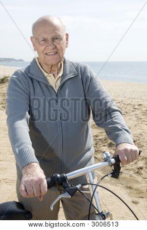 Active Senior Man Riding His Bike