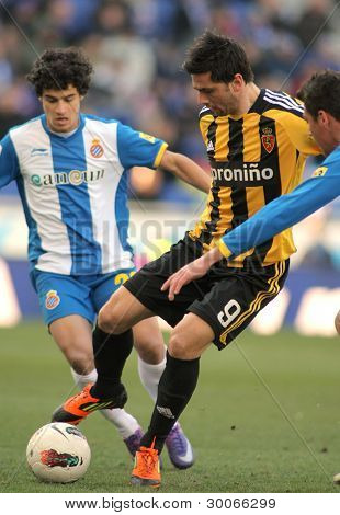 BARCELONA - FEB, 12: Helder Postiga(R) of Real Zaragoza vies with Coutinho(L) of RCD Espanyol during a Spanish League match at the Estadi Cornella on February 12, 2012 in Barcelona, Spain