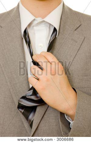 Stressful Businessman Untying His Necktie