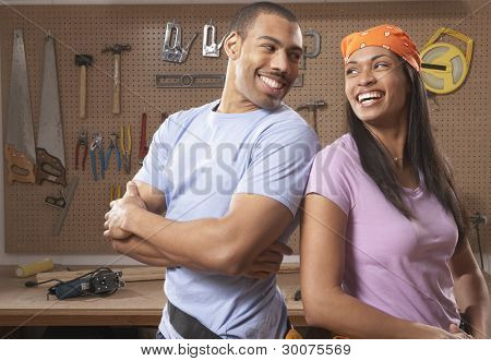 Couple laughing in workshop