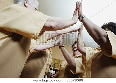 Woman giving each other high fives
