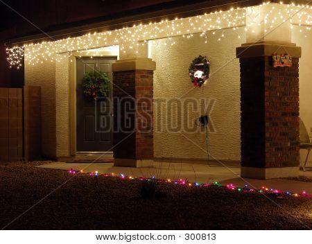 Stucco Christmas Lit Entryway