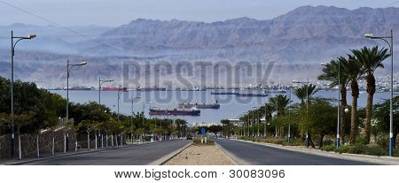 View on the Aqaba gulf (Red Sea) from lokal street of Eilat, Israel