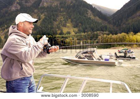 Salmon Fisherman Catching A Fish