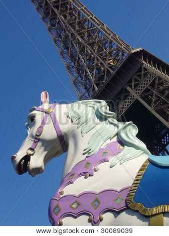 The Eiffel Tower behind a carousel horse