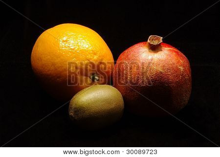 Orange with pomegranade and kiwi fruit
