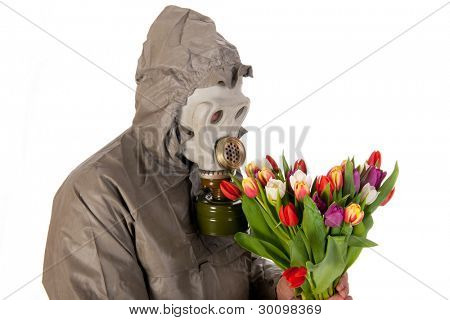 Man dressed in protection suit and gas mask with colorful flowers