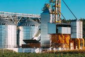 Modern Granary, Grain-drying Complex, Commercial Grain Or Seed Silos In Sunny Summer Rural Landscape poster