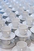 foto of coffee-cup  - Many rows of pure white cup and saucer