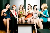 stock photo of leggy  - Young couple with Champagne in club or party having fun - JPG