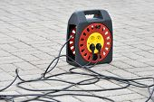 Electrical Extension Cord With Plugs, Extension Lead. Electric Extension Cord On Ground poster