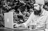 Hipster Relax Sit Terrace With Beer. Bearded Hipster Freelancer Enjoy End Of Working Day With Beer M poster