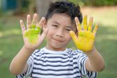 Little Boy Hands Painted In Colorful Paints. Happy Funny Child Draws Laughing Shows Hands Dirty With poster