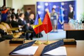Romania And China Flags One Next To The Other On A Table, Near Two Signed Documents. China-romania B poster