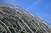 foto of geodesic  - Close up view of geodesic structure with blue sky background - JPG
