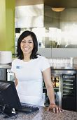 stock photo of cashiers  - Portrait of teenage girl cashier in restaurant - JPG