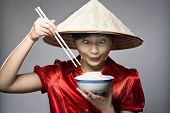 picture of stereotype  - A young Asian girl comically lampooning an Asian stereotype  - JPG