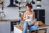 Pretty Woman In Casual Clothes Having Fun While Preparing Dough At Stylish Kitchen. Young Pretty Wom poster