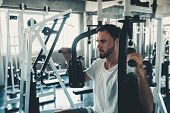 Handsome Man Is Exercising With Pectoral Machine In Fitness Club.,portrait Of Strong Man Doing Worki poster
