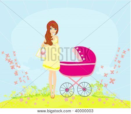 Beautiful Pregnant Woman Pushing A Stroller