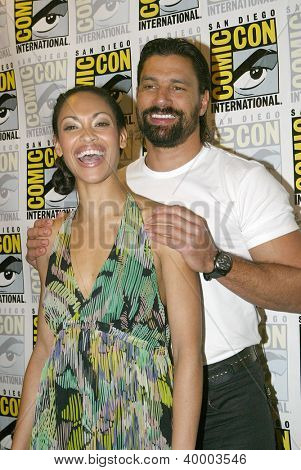 SAN DIEGO, CA - JULY 13: Manu Bennett and Cynthia Addai-Robinson arrives at the 2012 Comic Con convention press room at the Bayfront Hilton Hotel on Friday, July 13, 2012 in San Diego, CA.