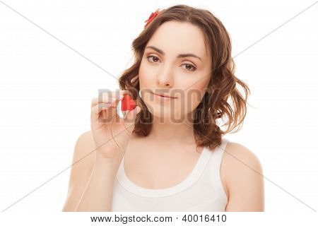 Young Woman With Heart Shaped Cookie