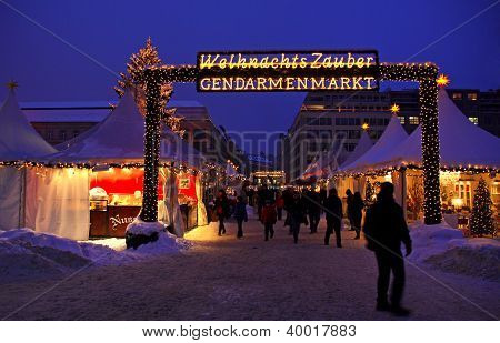 People Walking During Christmas Market At Gendarmenmarkt Square In Berlin, Germany