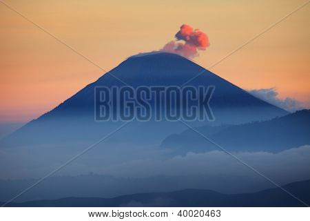 Active Semeru volcanoe with some ash smoke frome it at twilight