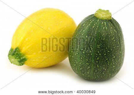 yellow and green zucchini (Cucurbita pepo) on a white background