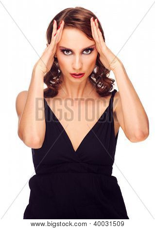 Portrait of young beautiful woman suffering from severe headache, against white background