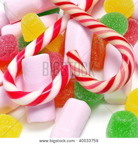 closeup of a pile of candy canes, gumdrops and marshmallows