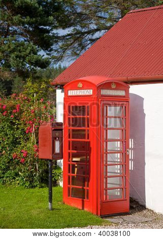Iconic Red Lamp Box post box and telephone kiosk in Scotland