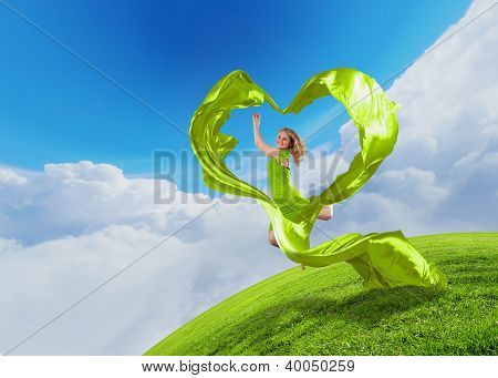 Female dancer and green heart symbol from fabrique