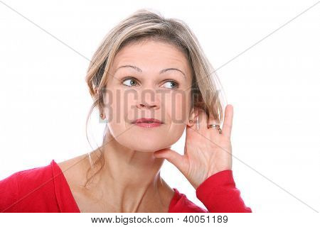 Middle aged blonde in listening gesture over a white background