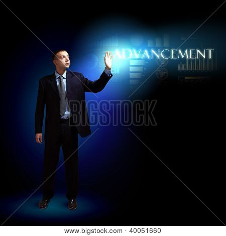 Young successful businessman holding a shining light in his hand as a symbol of success and advancement.