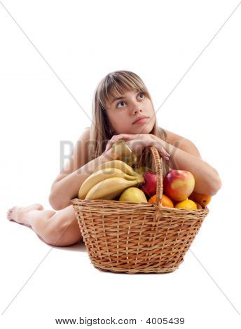 Pretty Girl Lying Behind Fruit Basket