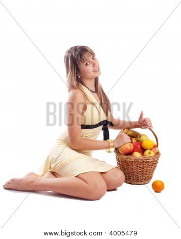 Girl In Yellow Dress Sitting Beside Fruit Basket