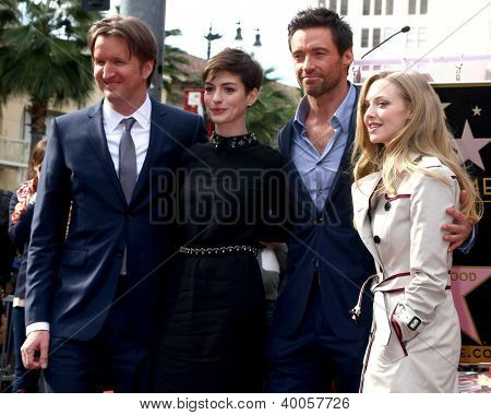 LOS ANGELES - DEC 13:  Tom Hooper, Anne Hathaway, Hugh Jackman, Amanda Seyfried at the Hollywood Walk of Fame ceremony for Hugh Jackman at Hollywood Boulevard on December 13, 2012 in Los Angeles, CA