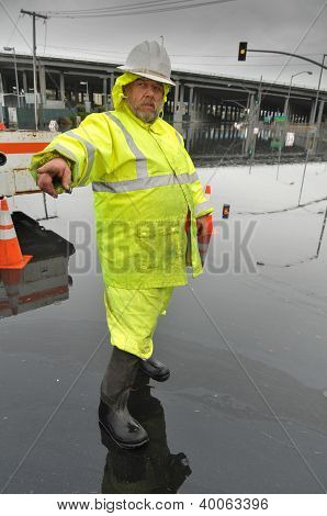 State Worker Directs Traffic From Flood Area