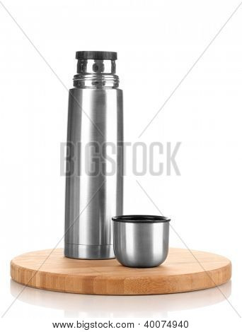 metal thermos on wooden board isolated on white