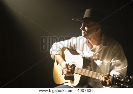 Cowboy Playing Guitar