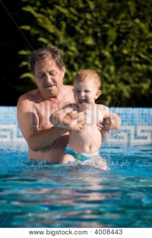 Grandfather Swimming With Grandson