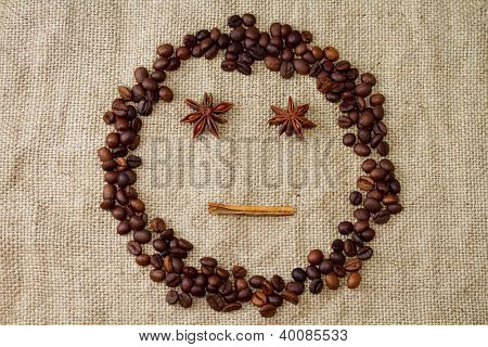 Cheerful smiley of coffee beans on a canvas background
