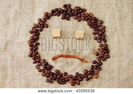Sad smiley of coffee beans
